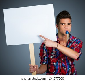 Young man protesting with protest sign