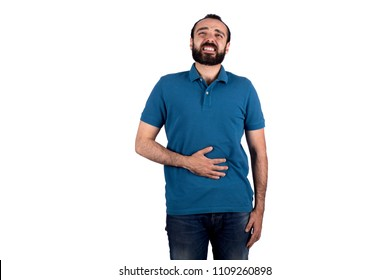 Young man putting his hand on the stomach feels pain, isolated on a white background.