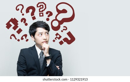 young man with question marks.