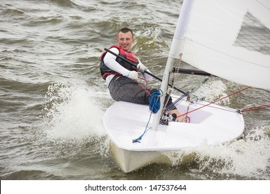 The young man quickly moves on a sports yacht