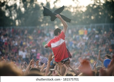 Young man raised by the crowd during a concert