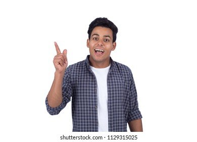 Young man raising a finger got a good idea, isolated on a white background.