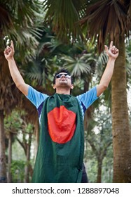 Young man raising two hands with the Bangladeshi national flag