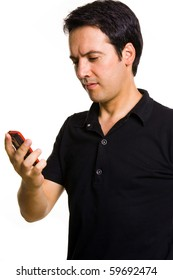 Young man read a message on the cell phone, isolated on white