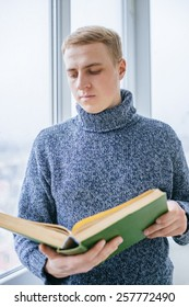 young man reading book