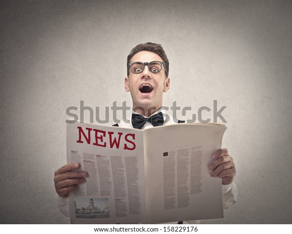 young man reading the newspaper