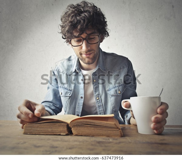 Young man reading an old book