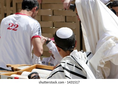 Young man reading from the Thora during his Bar Mitzvah at the western Wall.Jerusalem,Israel