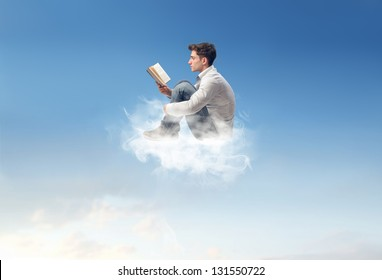 young man reads sitting on a cloud