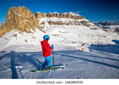 Young man ready for skiing in Dolomity super ski resort, Italy, Europe.