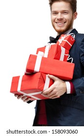 Young man received a lot of presents in red packaging, isolated on white