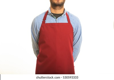 Young man with red apron in the kitchen, white background