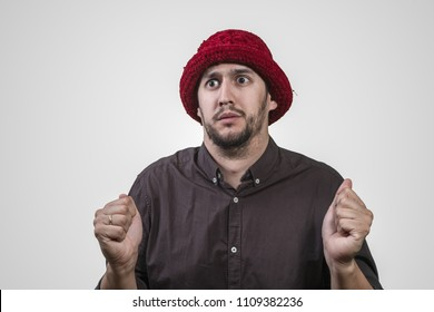 young man with red hat and with attitude of terror