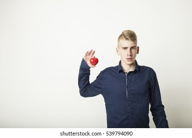 Young man with red heart.