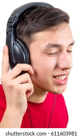 young man in red shirt with headphones listening to music isolated on white background