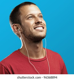 young man with a red shirt on a blue background