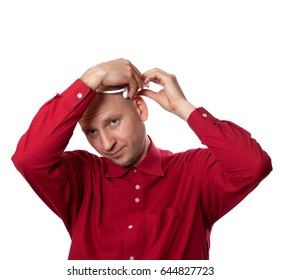 Young man in red shirt puts on head headset EEG (electroencephalography). Isolated on white background.