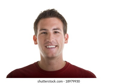A young man in a red shirt smiling at the camera