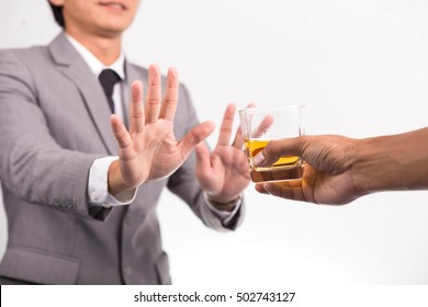 Young man refuses Alcohol on the White Background
