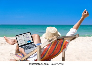 Young man relax on the beach happy lifestyle. White sand, blue cloudy sky and crystal sea of tropical beach. Vacation at beach asian. Ocean beach relax, travel to with notebook and listen to music
