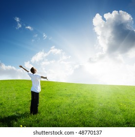 young man relax on the green field