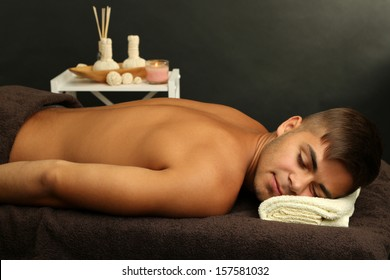 Young man relaxed in spa salon