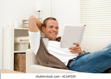young man relaxing with book