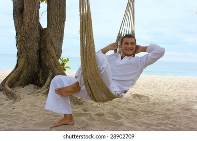 Young man relaxing on the sand beach