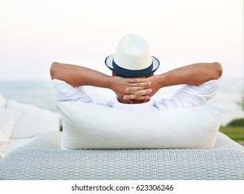 Young man relaxing outdoor on the chair. Lifestyle concept
