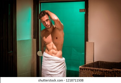 Young Man Relaxing in Sauna, Going Out with Only a Towel Around his Waist, Showing Sexy Muscular Body