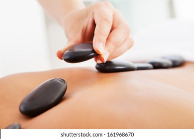 Young Man Relaxing In A Spa Getting Lastone Therapy