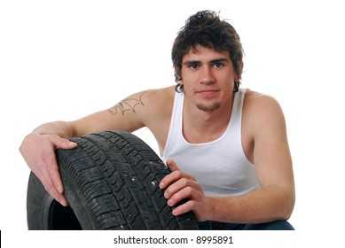 A young man repairing a tire