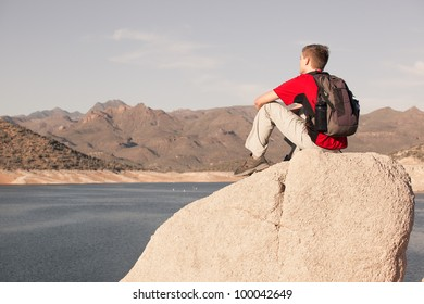 Young Man Resting by Desert Lake