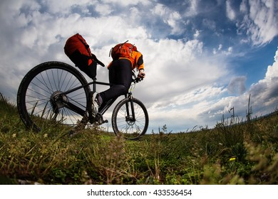 Young man is riding bicycle outside. Healthy Lifestyle.