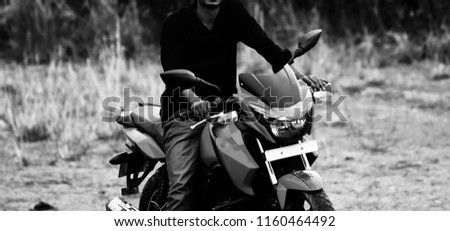 Young man riding a bike wearing black shirt isolated unique photo