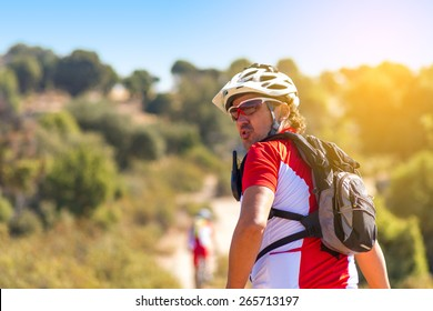 A young man riding a mountain bike outdoor