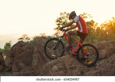 young man riding mountain bike on forest trail