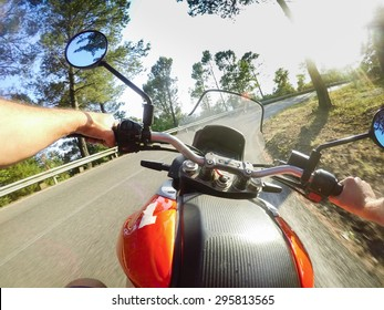 Young man riding on motorbike. POV Original Point of View