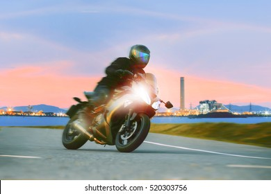 young man riding sport touring motorcycle on road for leisure traveling theme