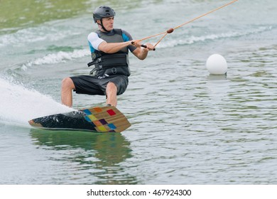 Young man riding wakeboard at high speed