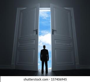 young man in room with big door to sky & Big Doors Images Stock Photos u0026 Vectors | Shutterstock