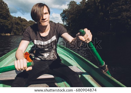 Young Man Rowing Wooden Boat On Stock Photo Edit Now 680904874