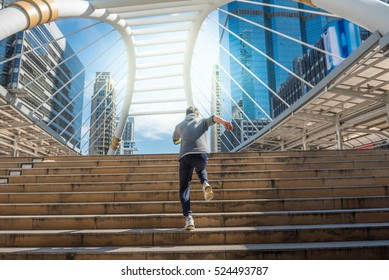 Young man Run into a future on the cityscape background, business successful concepts.