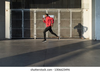 Young man running in the city,
