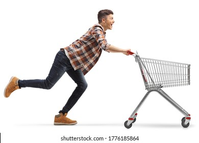 Young man running with an empty shopping cart isolated on white background