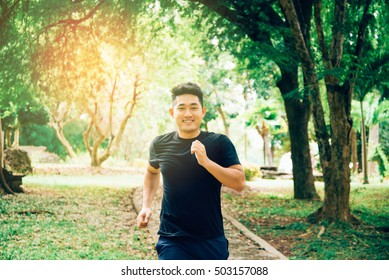 A young man running in the nature. Healthy lifestyle