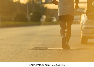 Young man  running on city road in evening,copy space.