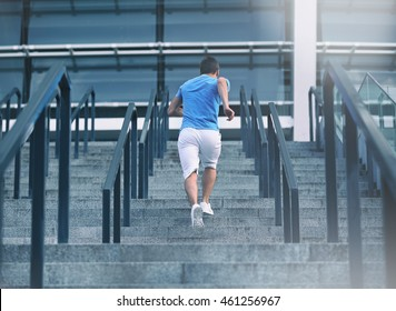 Young man running on stairs