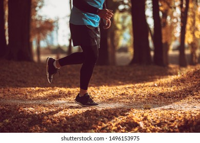 Young man is running in sunny nature.