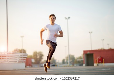 Young man running in urban area
